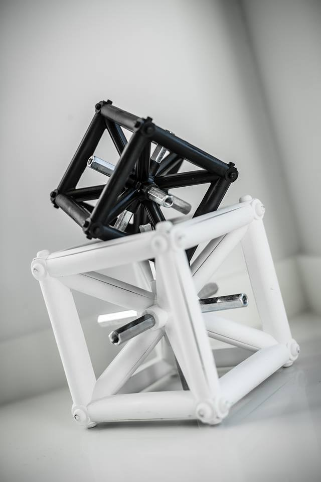 Component parts of a trussing stand in white and black