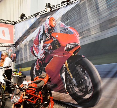 Truss exhibition stand with motorbike sales banner