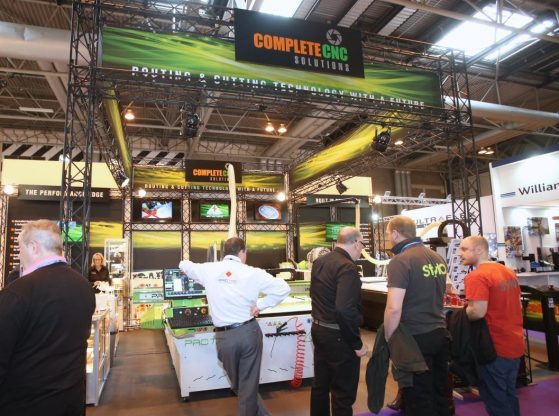 Why is it important to visit trade shows as well as exhibiting?